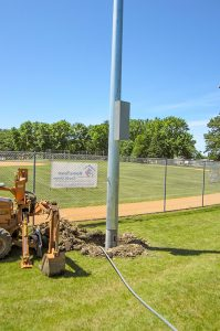 Cole's Electrical lightpost at baseball field
