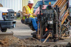 Crew member working on underground boring machine