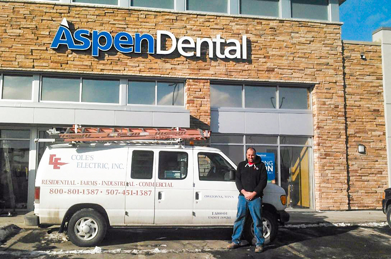 Cole's Electric employee with white van outside Aspen Dental