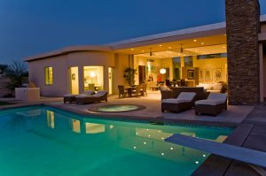 Residential home at night with pool